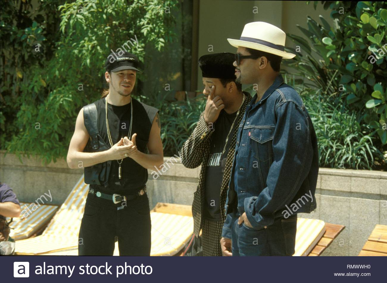 Donnie Wahlberg of New Kids on the Block is shown talking with Run DMC at the Rio Palace Hotel during Rock in Rio II. - Stock Image