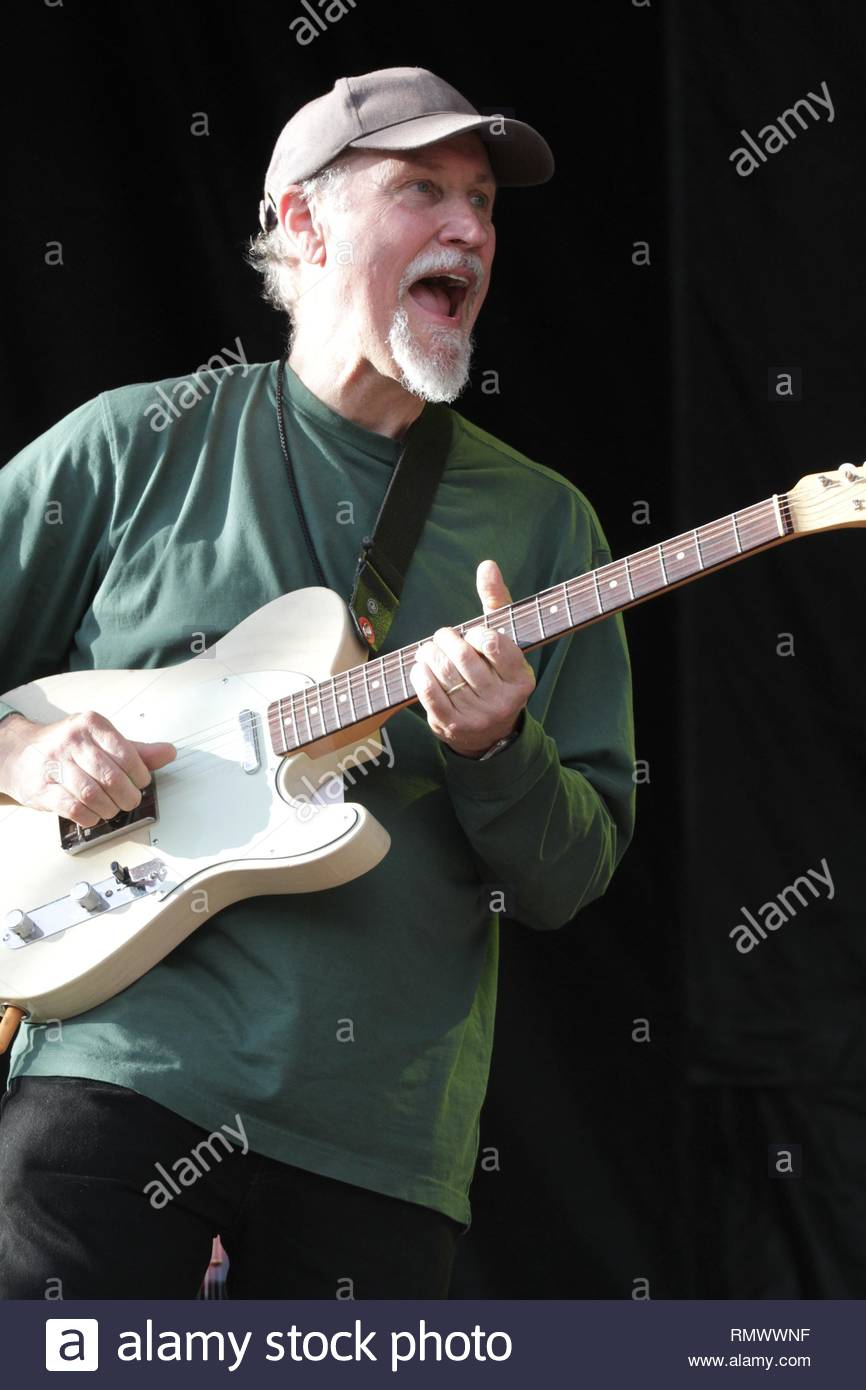 Guitarist John Scofield is shown performing on stage during a 'live' concert appearance with Phil Lesh & Friends. - Stock Image