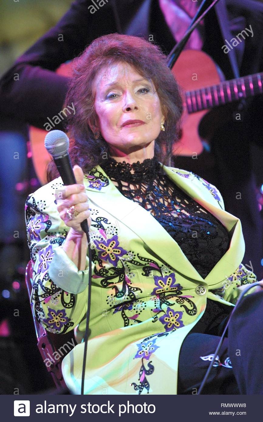 Country music singer, songwriter Loretta Lynn, one of the leading country vocalists and songwriters during the 1960s and 1970s and is revered as a country icon, is shown performing on stage during a 'live' concert appearance. - Stock Image