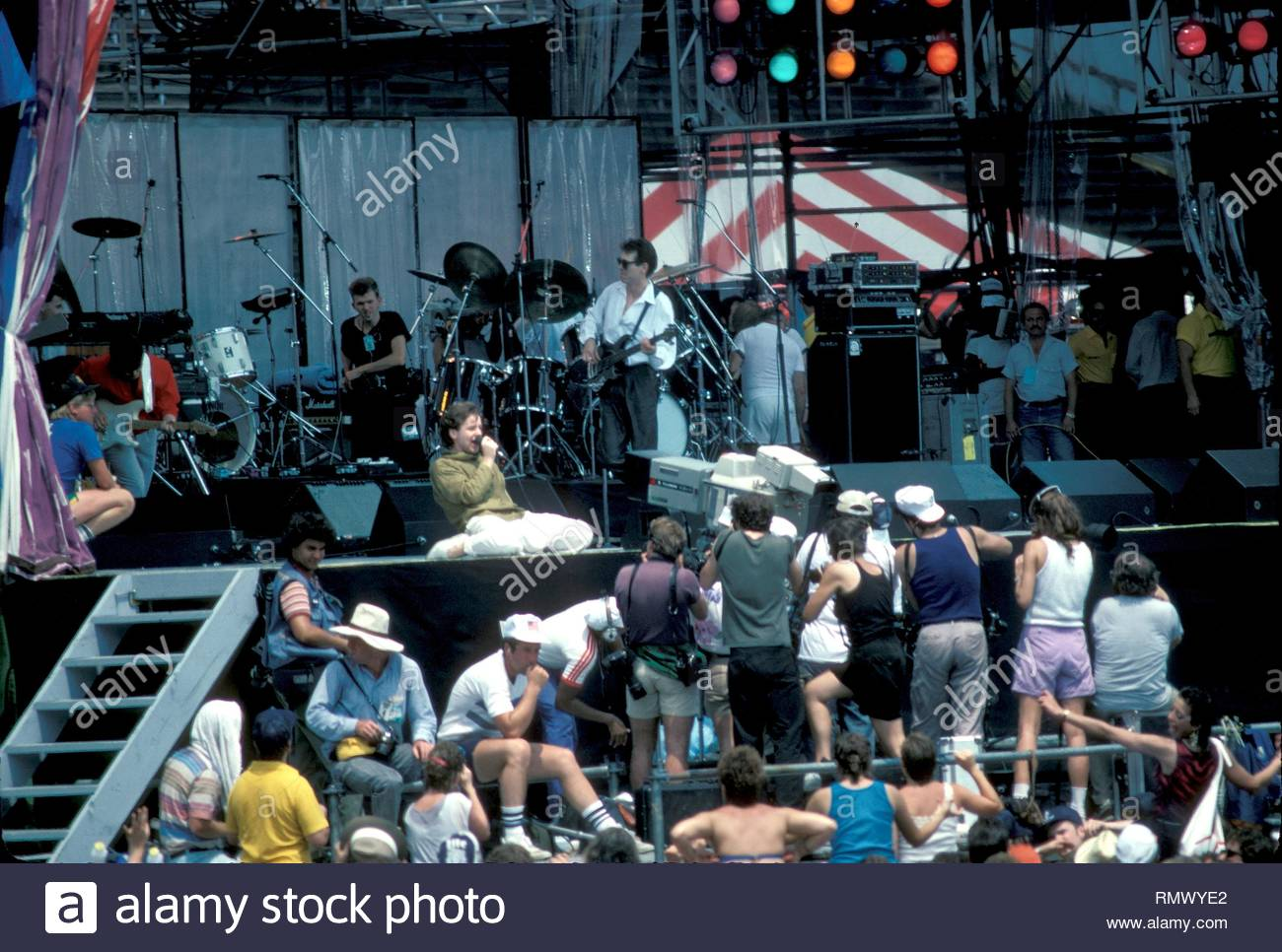 Scottish musician, singer and songwriter Jim Kerr, famous for his work with the band Simple Minds, is shown performing on stage at Live Aid in Philadelphia back in 1985. - Stock Image