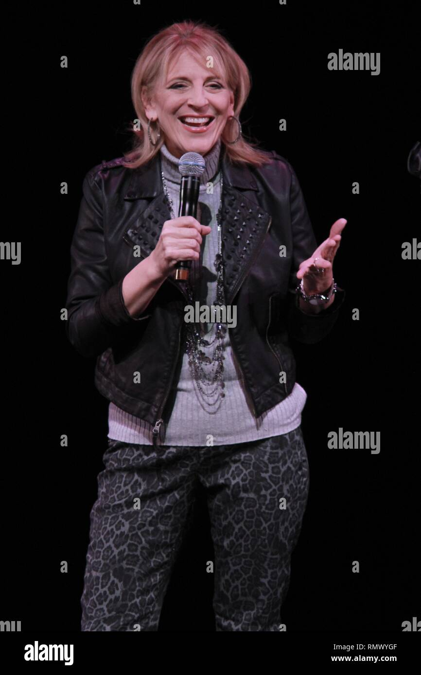 Stand-up comedian and insult comic Lisa Lampanelli is shown performing on stage during a 'live' concert appearance. - Stock Image