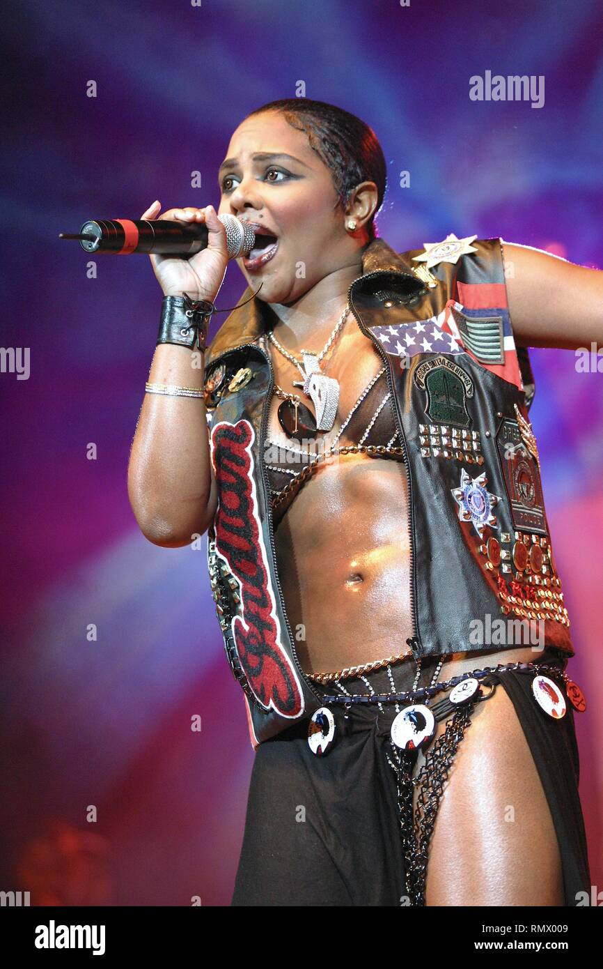 "Grammy Award winning, multi-platinum rapper and singer, Kimberly Jones, better known by her stage name Lil' Kim, is shown performing on stage during a ""live"" concert appearance.. Stock Photo"