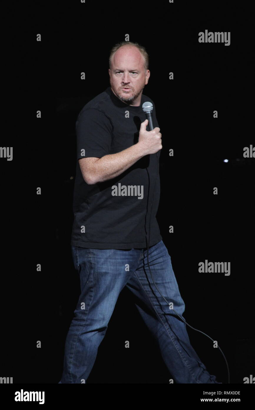 Comedian, screenwriter, producer, film director and actor Louis C.K. (Louis Szekely) is shown performing on stage during a 'live' stand up concert appearance. - Stock Image