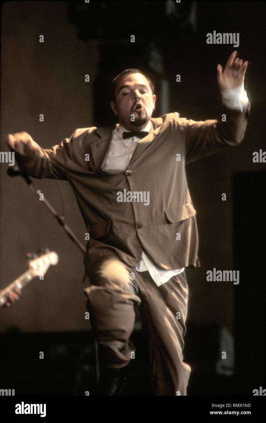 A band member of the Mighty Mighty Bosstones is shown performing on stage during a 'live' concert appearance.pic, pic, picture, pictures, photo, photos, photograph, photographs, online, digital, download - Stock Image