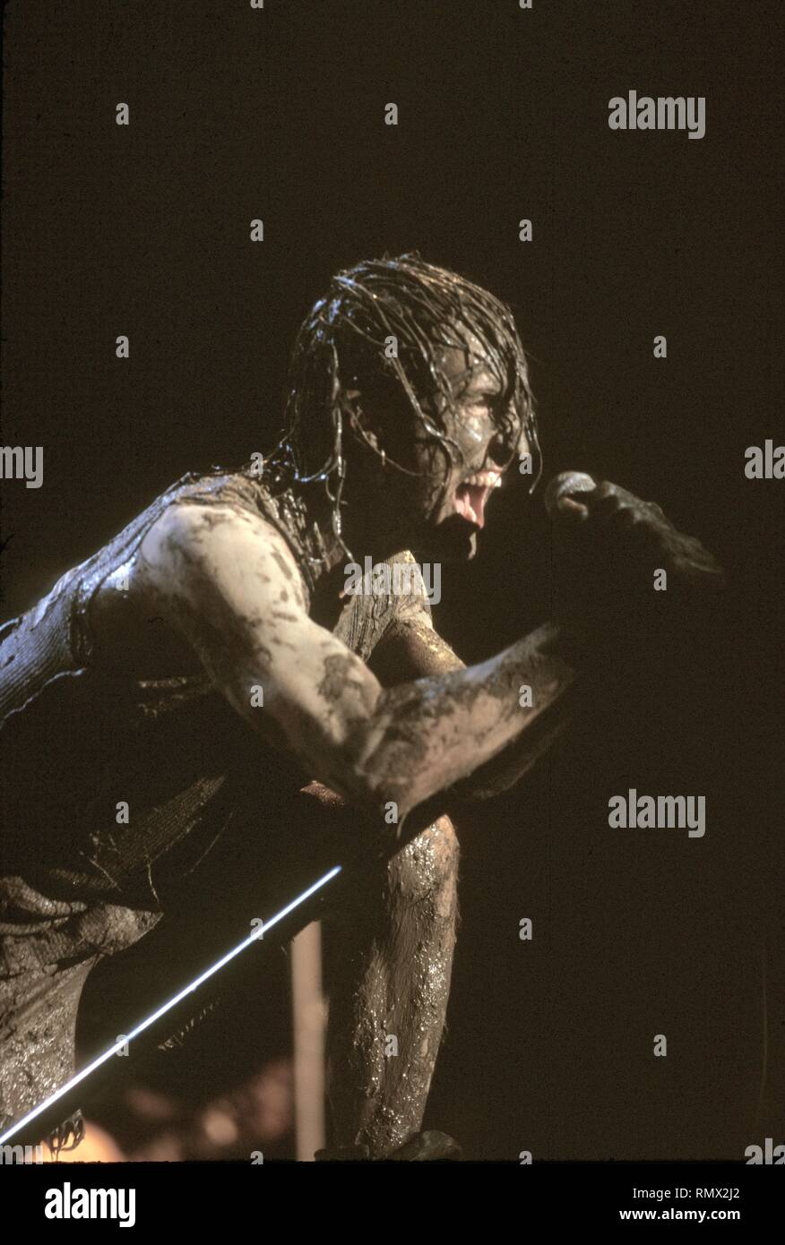 Singer Trent Reznor of the Industrial rock act Nine Inch Nails is shown performing on stage at Woodstock '94. - Stock Image