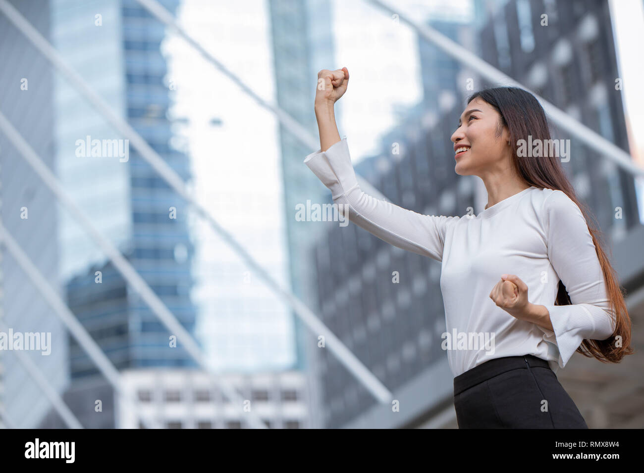 Women Rise Her Hand For Business Winner Success Concept With Office Building Background Stock Photo Alamy