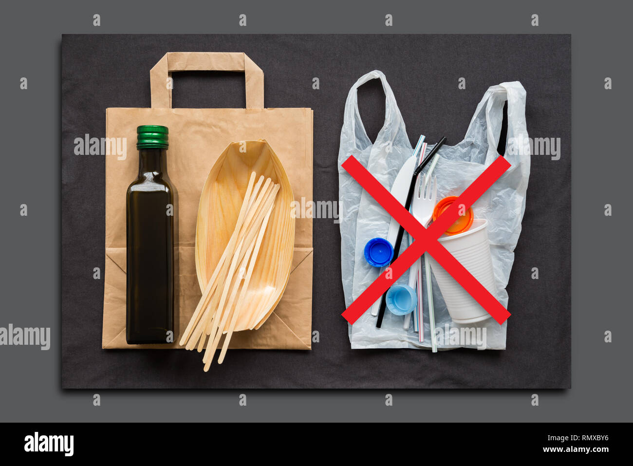 Eco-friendly dishes made of wood and paper as opposed to single-use plastic and other products harmful to the environment. The concept of choice witho - Stock Image