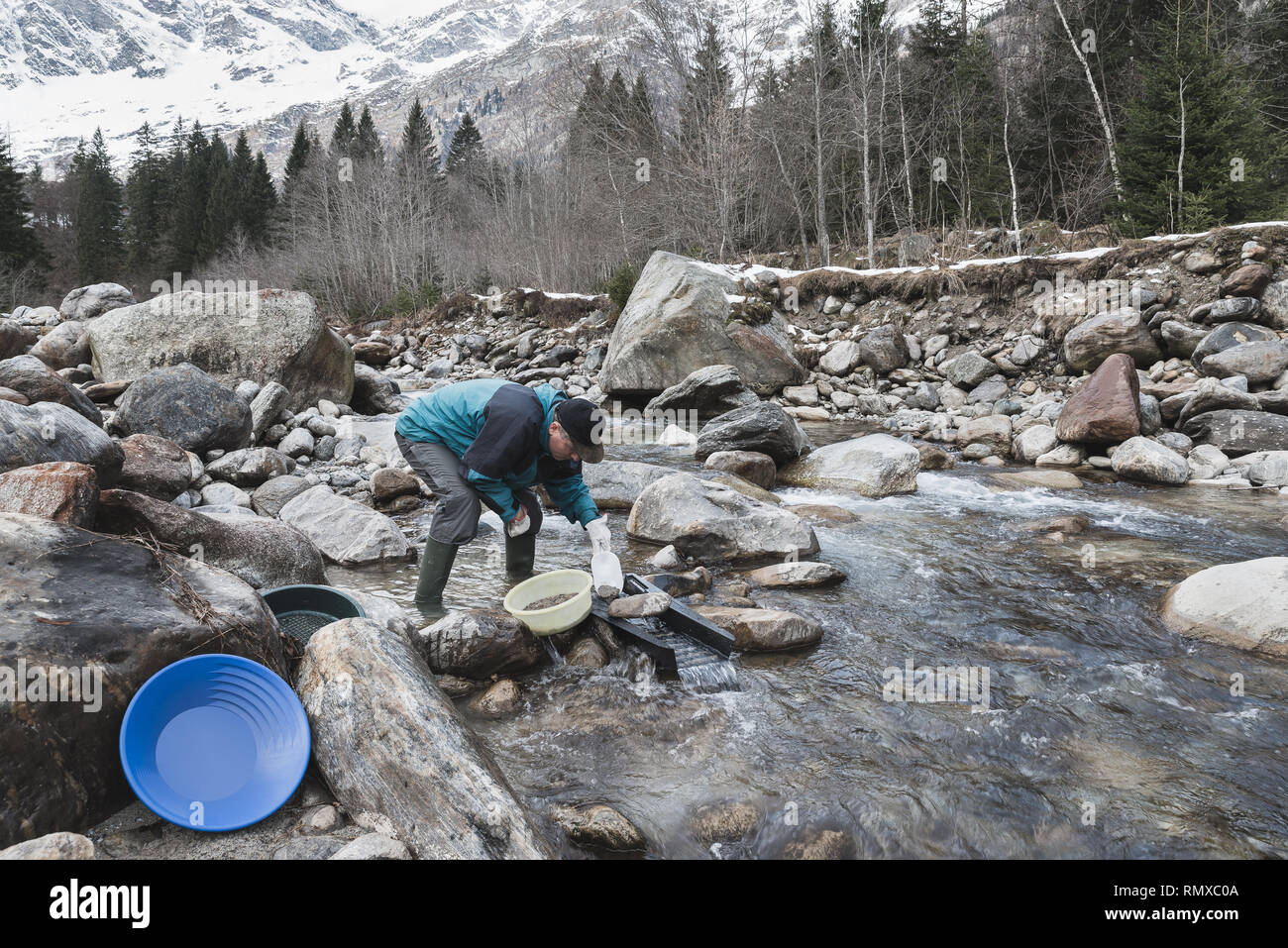 Adventures on river. Alluvial gold prospector. Moody instagram effect - Stock Image