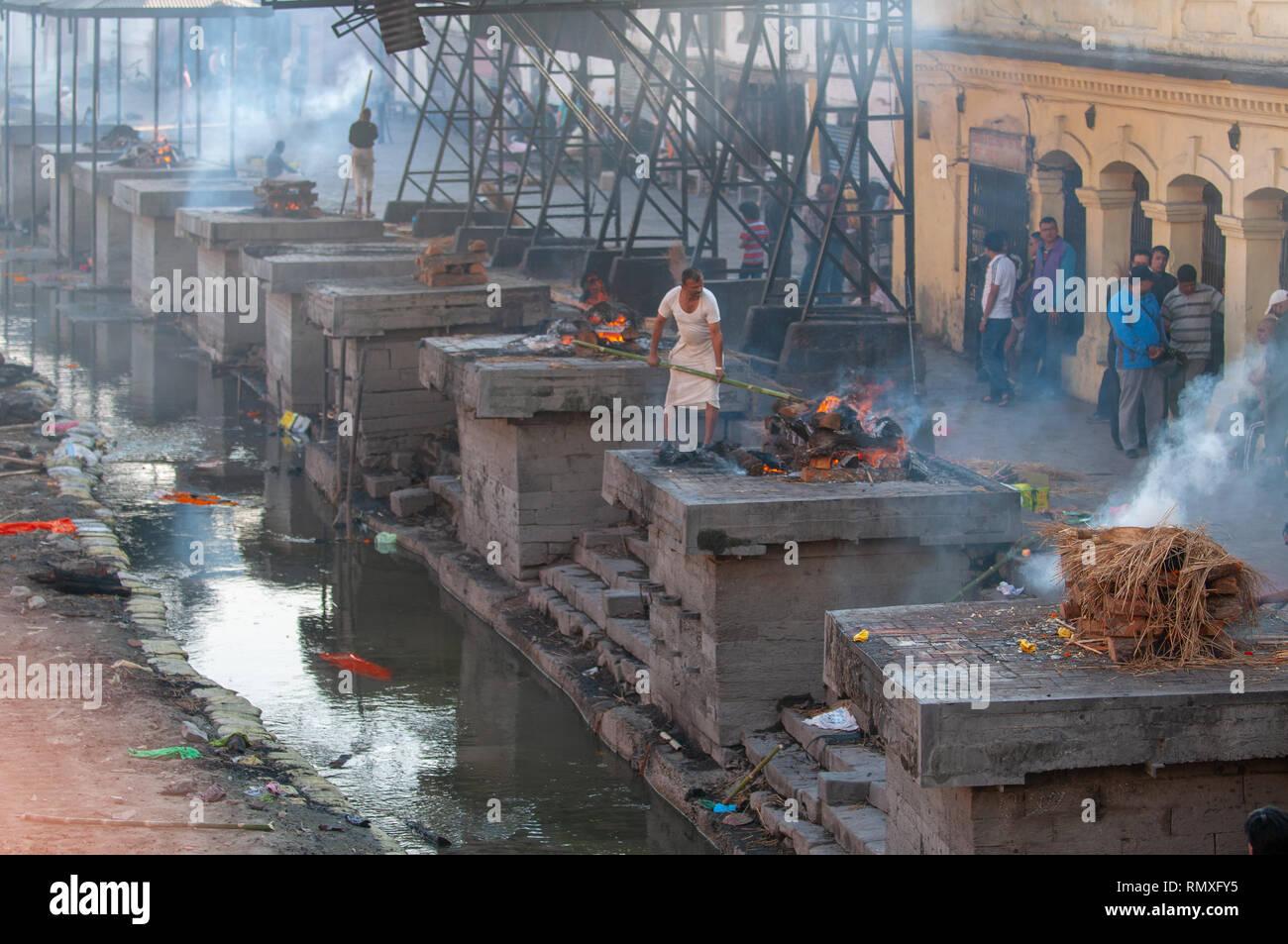 PASHUPATINATH, KATHMANDU, NEPAL-CIRCA 2013 : Hindu cremation process in progress at a temple in Pashupatinath, Nepal. - Stock Image