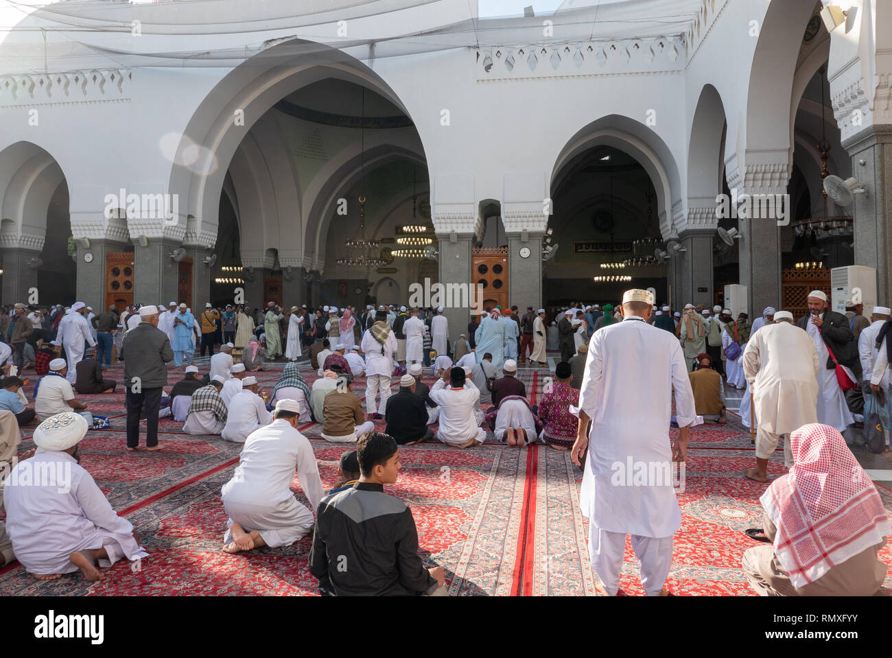 MEDINA, SAUDI ARABIA-CIRCA 2016 : Pilgrims pray inside Quba mosque in Medina. Quba mosque is the first mosque built by Prophet Mohammad (peace be upon - Stock Image