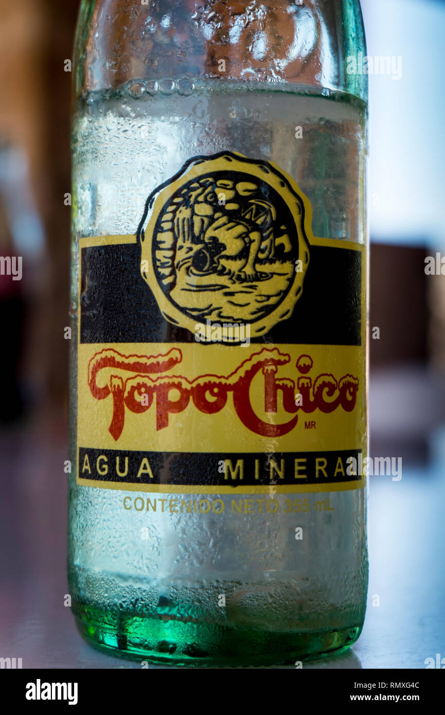 Cold Topo Chico sparkling mineral water, served in the town of Boquillas del Carmen in Mexico. - Stock Image