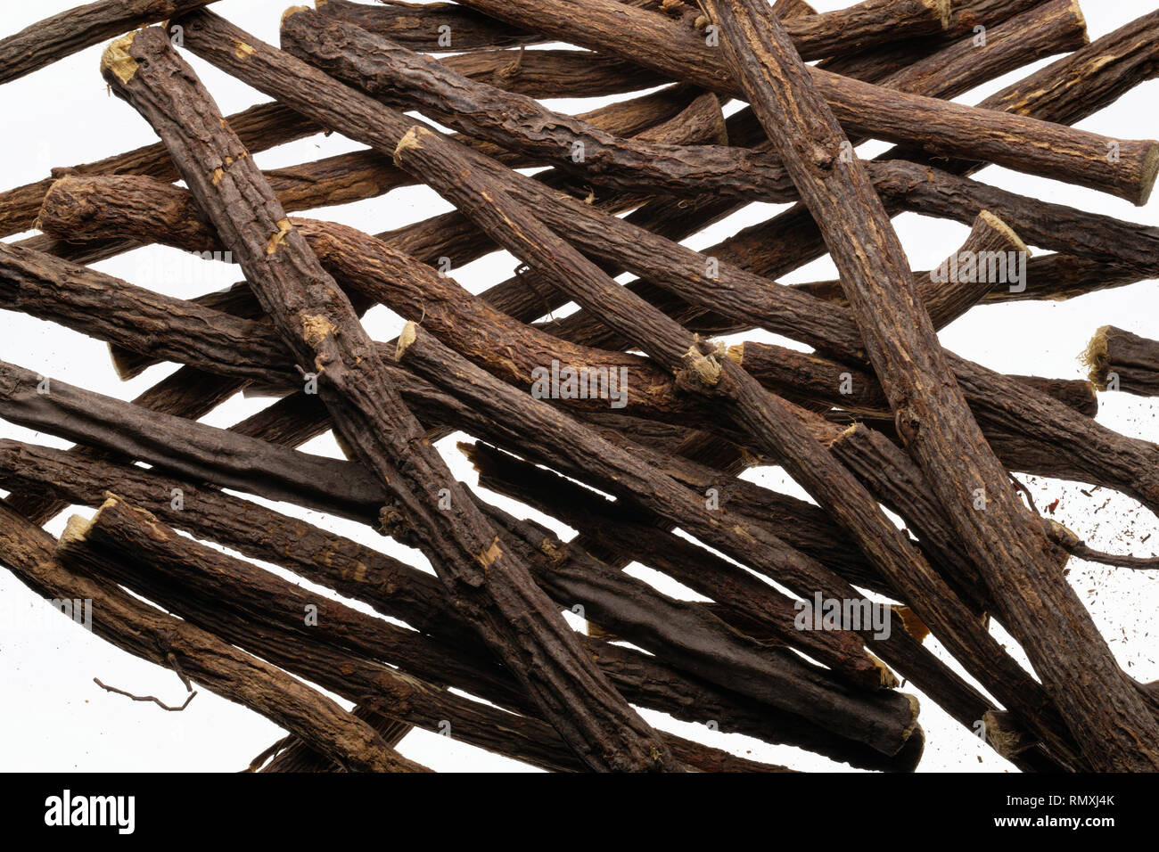 Liquorice root sticks from Asia, used for flavouring in cooking or confectionery. - Stock Image
