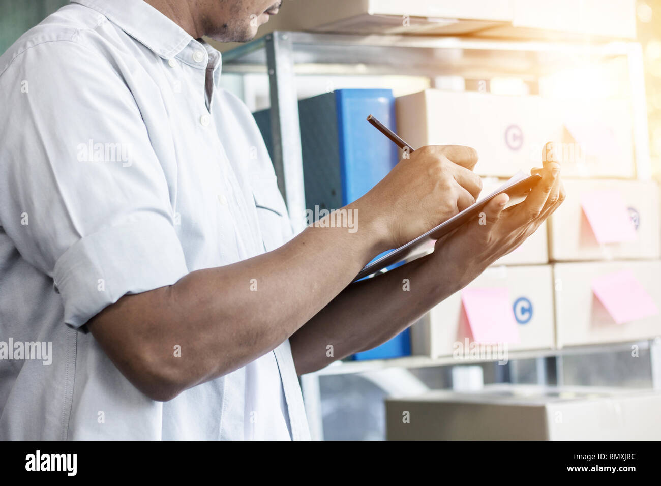 Officer checking products and stock Stock Photo
