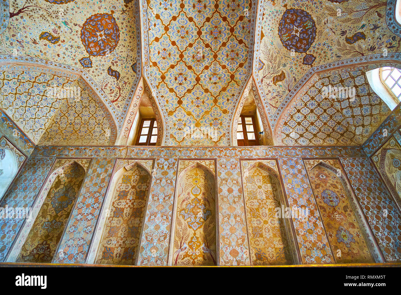 ISFAHAN, IRAN - OCTOBER 21, 2017: Decorative elements of Reception hall of medieval Ali Qapu Palace with complex walls and ceiling, covered with rich  Stock Photo