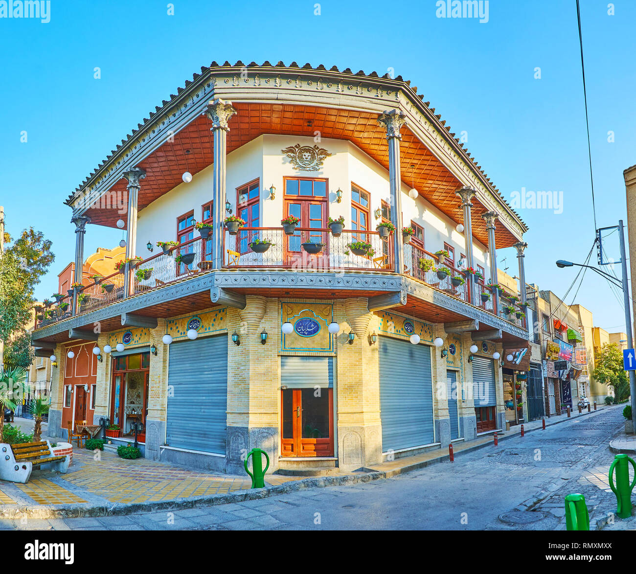ISFAHAN, IRAN - OCTOBER 21, 2017: The The scenic Armenian manison with corner facade, open terrace, tile decorations, stores on the ground floor and f Stock Photo