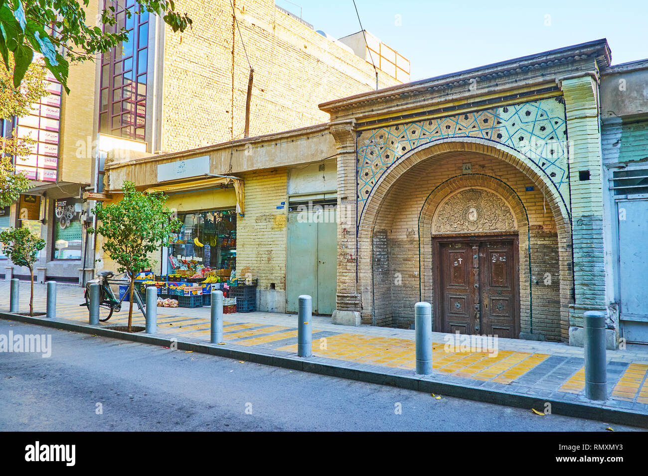 ISFAHAN, IRAN - OCTOBER 21, 2017: Historical Armenian Othodox church gate, decorated with carvings and tile patterns, located in New Julfa neighborhoo Stock Photo