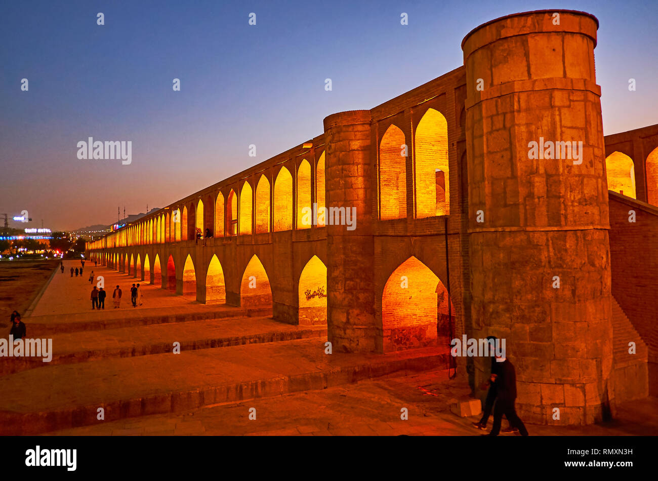ISFAHAN, IRAN - OCTOBER 21, 2017: Siosepol bridge is perfect place to watch from the Zayandeh river's bank or to walk along it during hot season, when Stock Photo