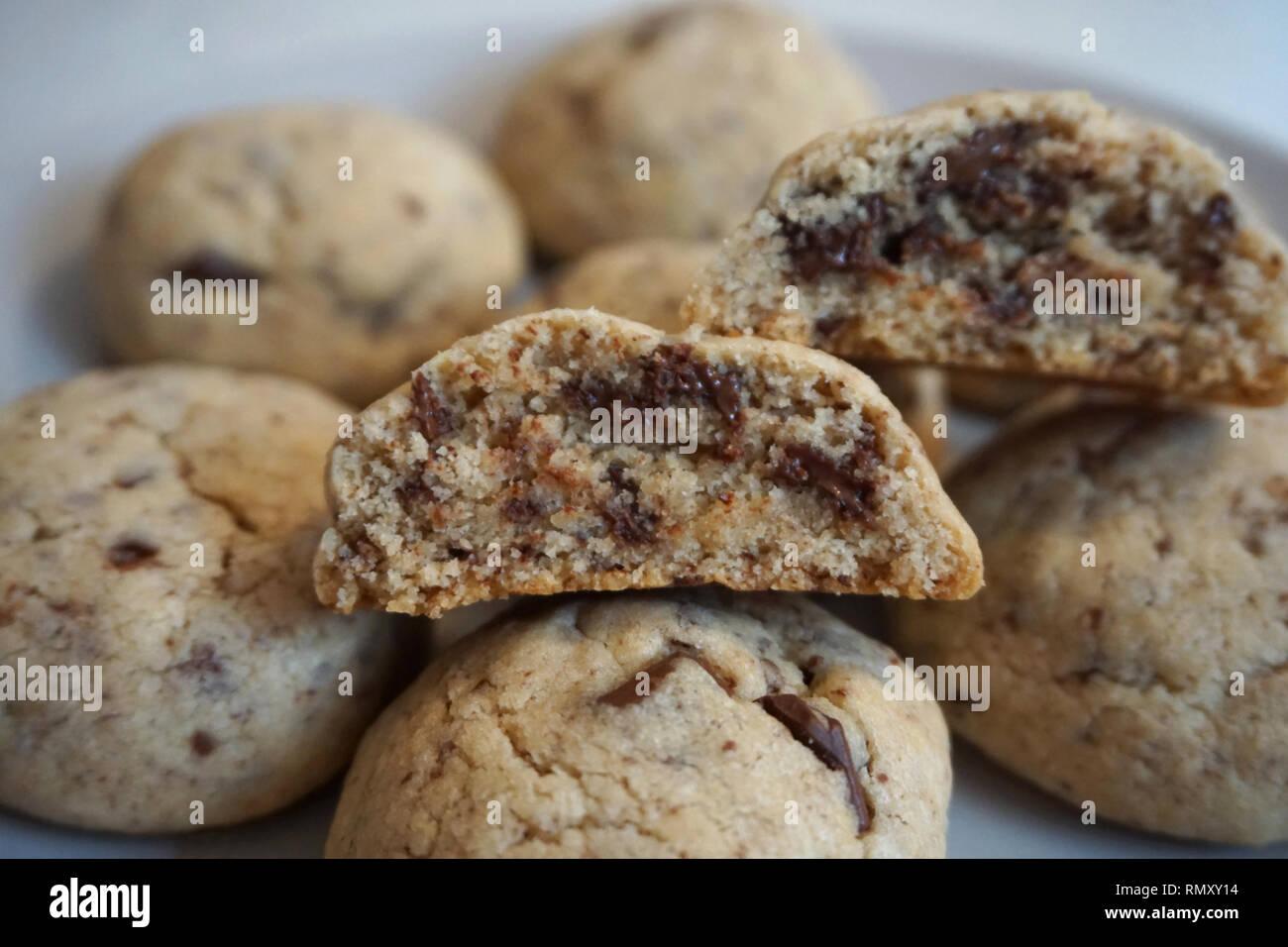 Halved cookie. Crunchy homemade tasty dessert with milk chocolate - Stock Image