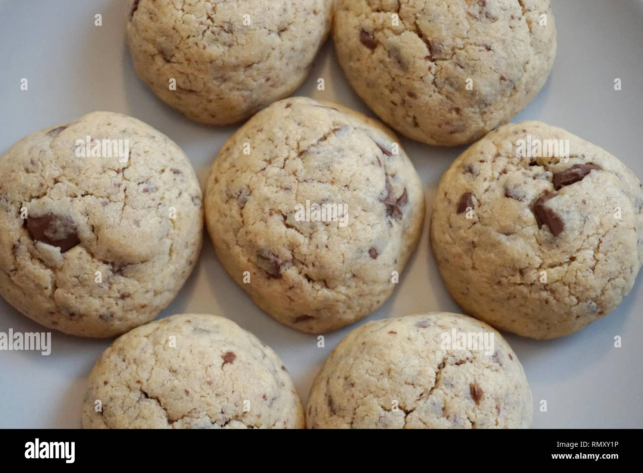 Baked tasty homemade butter cookies with pieces of dark chocolate, top view - Stock Image