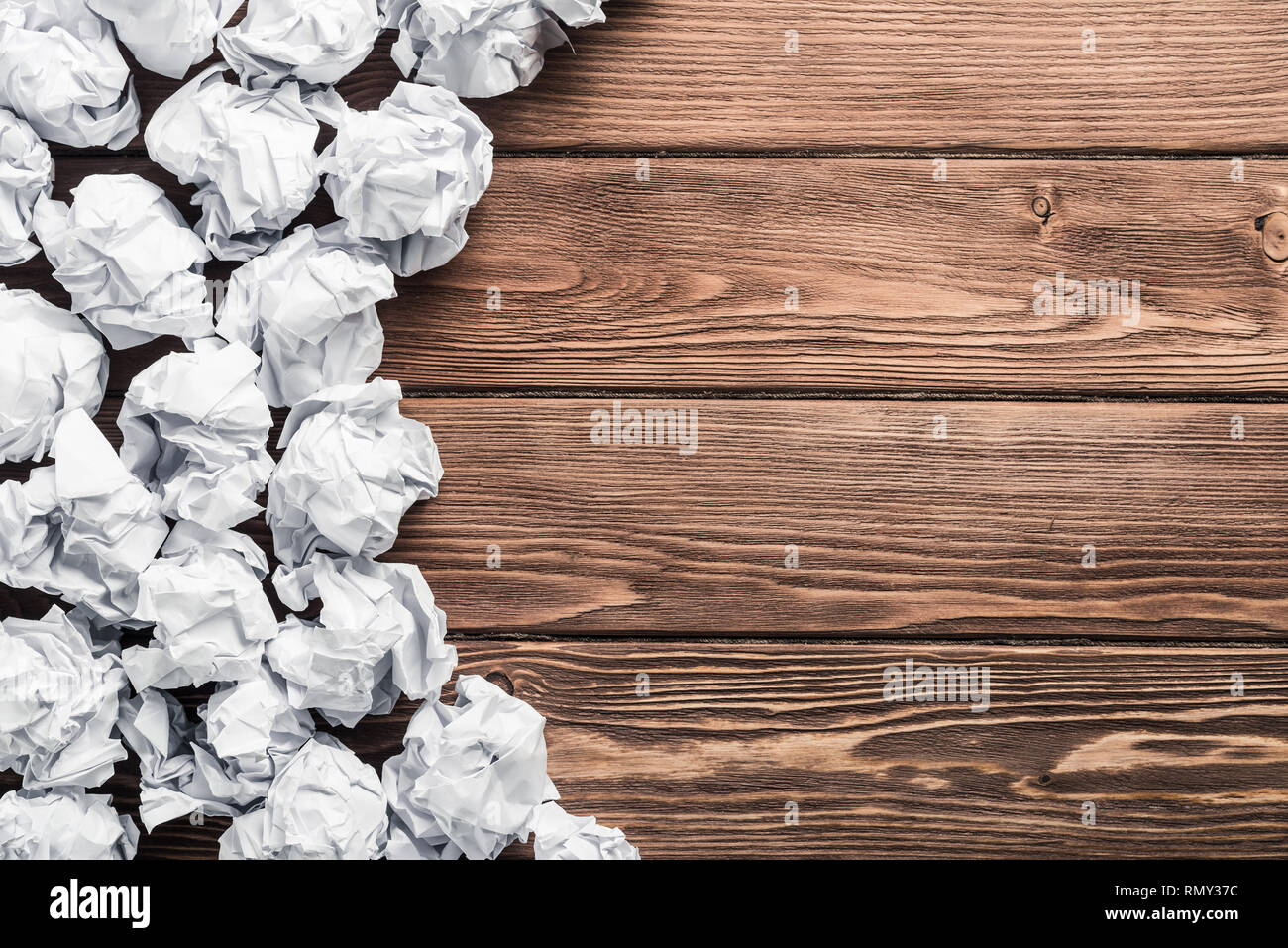 Ideological concept with wastepaper on wooden table - Stock Image