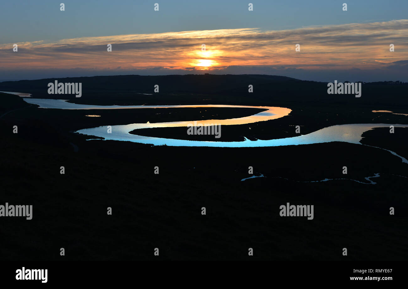 Meandering Cuckmere River at sunset, Cuckmere Haven, East Sussex, UK Stock Photo