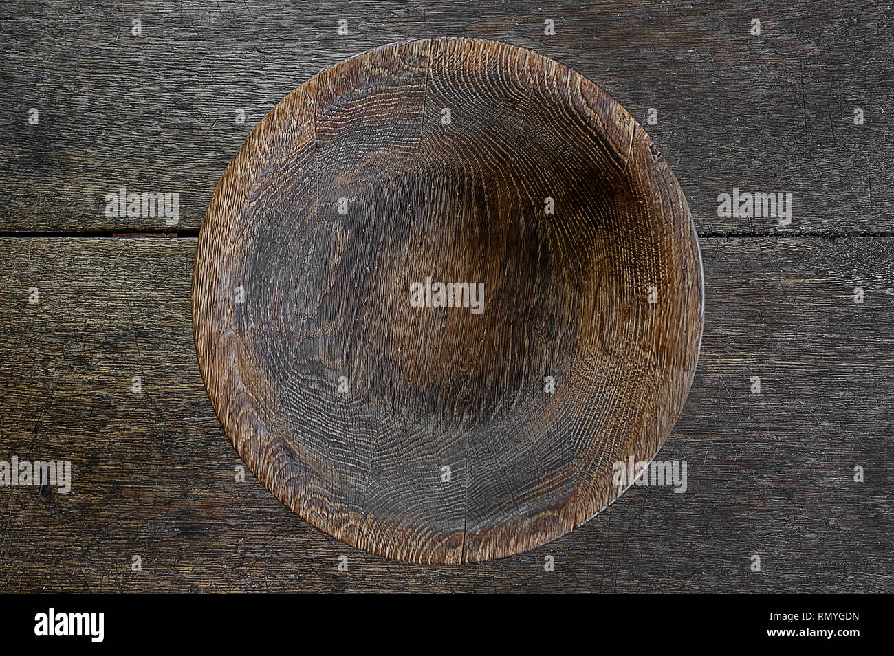 empty old wooden bowl on wooden table empty old wooden bowl on wooden table Stock Photo