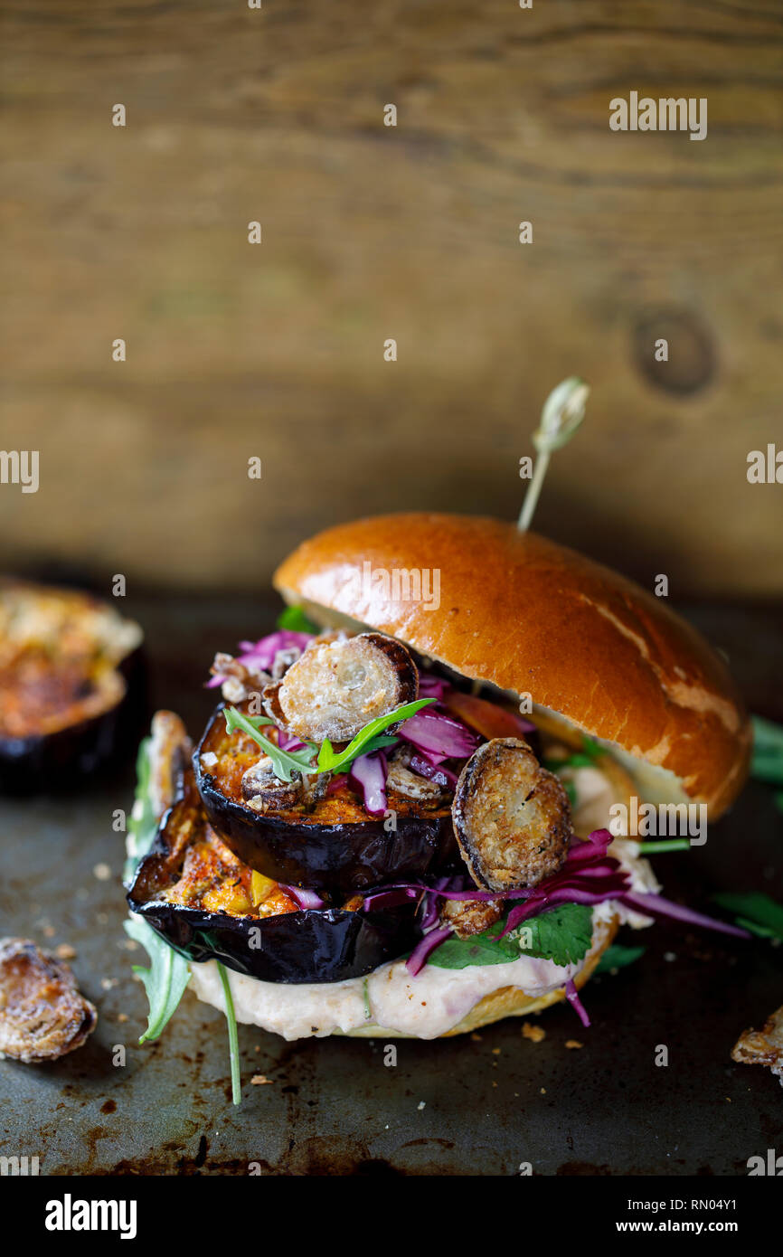 Vegan Burger With White Bean Puree And Spicy Aubergine Slices Stock Photo Alamy