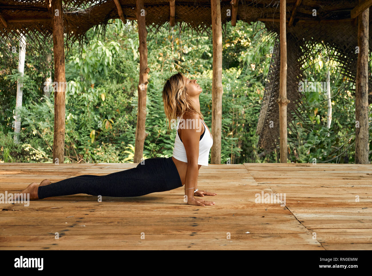 Woman Practicing Yoga In Tropical Open Yoga Studio Place Stock Photo Alamy
