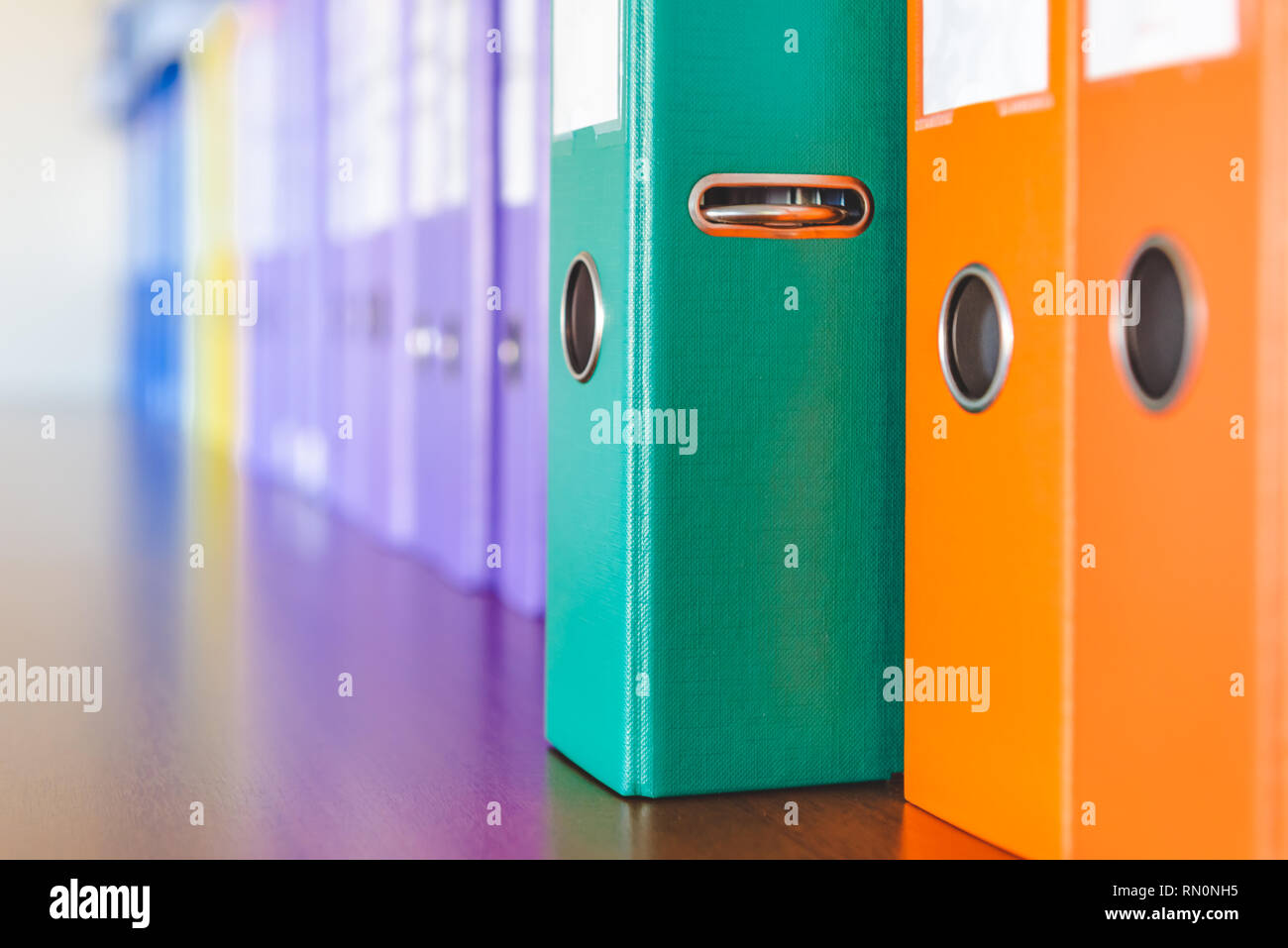 A row of binders for documents in the office - Stock Image