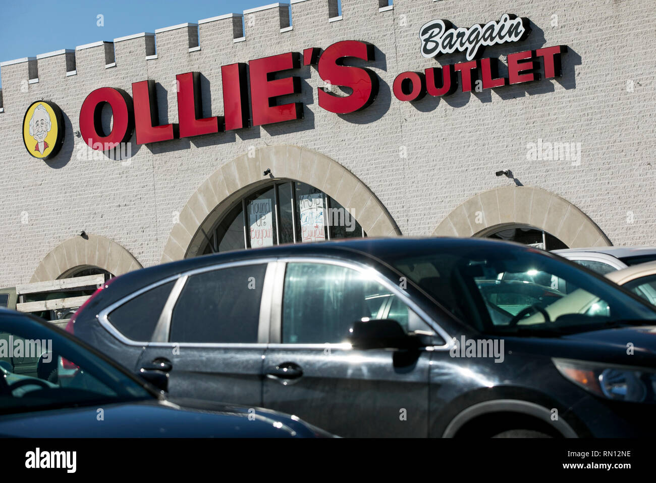 A logo sign outside of a Ollie's Bargain Outlet retail store in Lancaster, Pennsylvania on February 9, 2019. - Stock Image