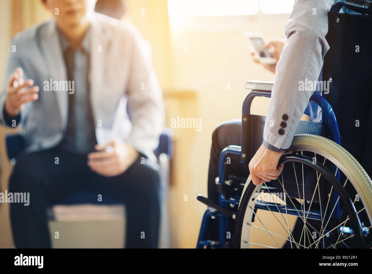 After car accident and rehabilitation, a businessman can return to work again. - Stock Image
