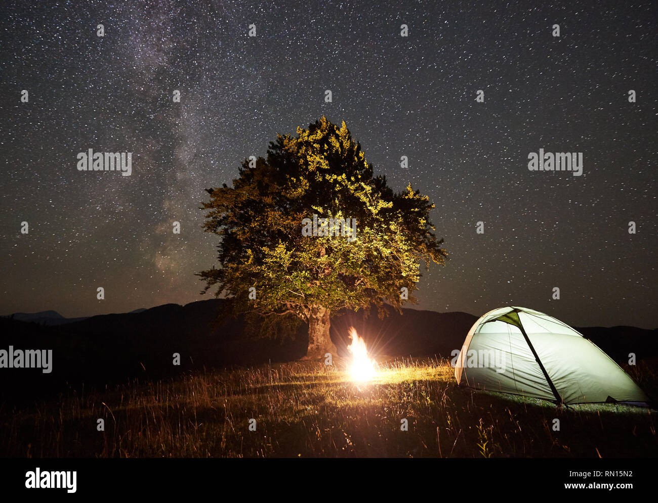 Dark Sky With Glowing Tent Stock Photos & Dark Sky With Glowing Tent