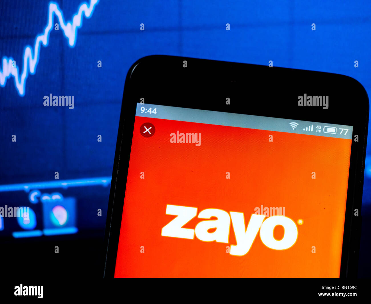 Zayo Group Holdings, Inc  logo seen displayed on smart phone