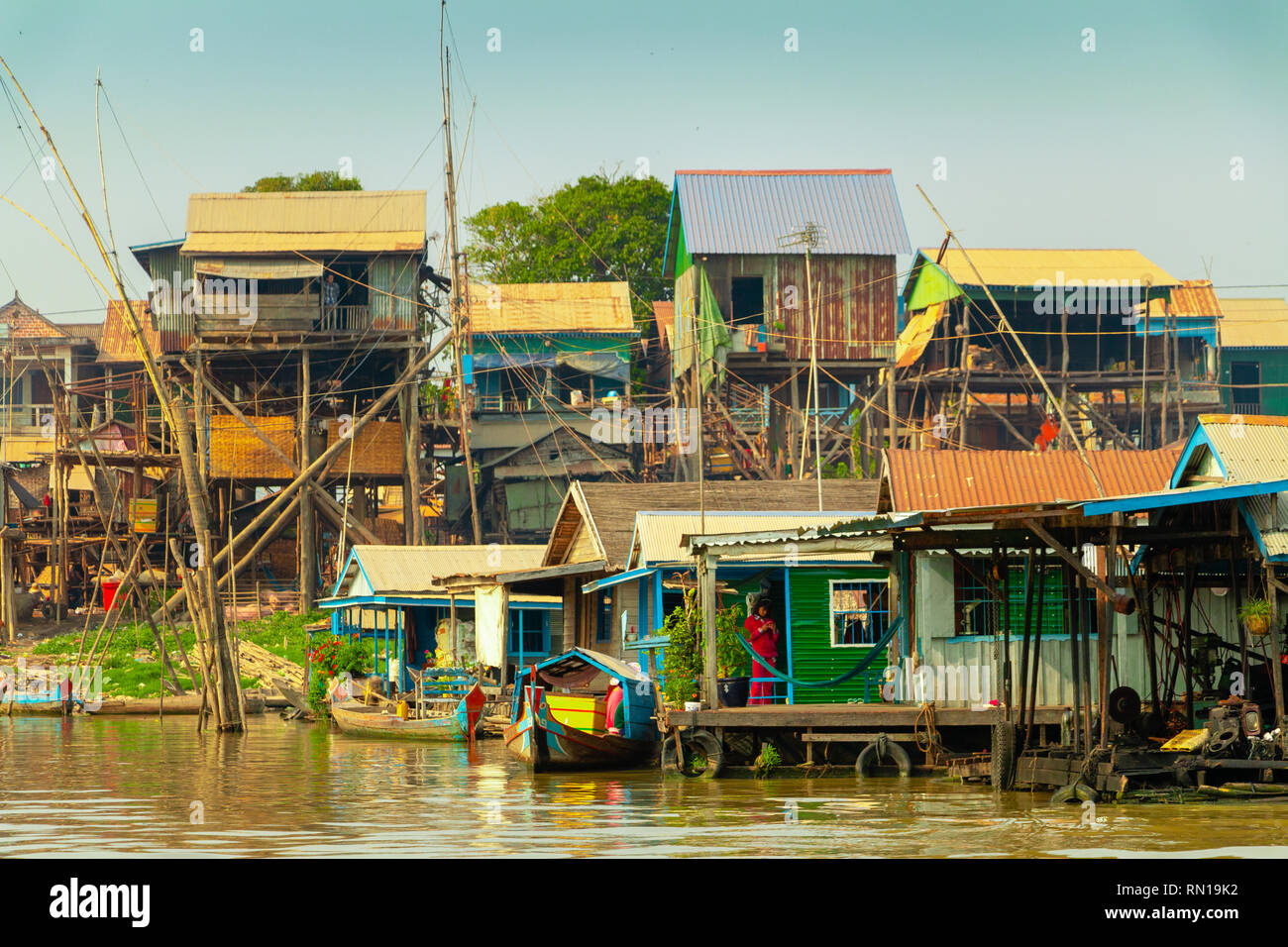 Wooden houses on stilts are home to many families in  floating village on Tonle Sap River, Kampong Chhnang, Mekong Delta, Cambodia, Asia Stock Photo