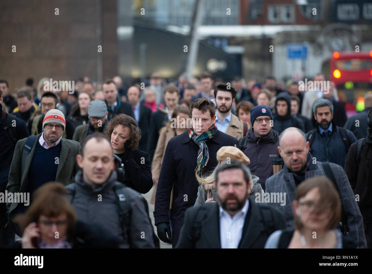Commuters make their way across London Bridge on 'Blue Monday', 18th January, traditionally the most depressing day of the year. - Stock Image
