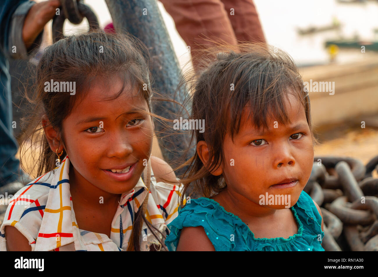 Portrait of a cute, happy,smiling, young, local,   primary school age Cambodian children playing outside   Kampong Tralach, Oudong, Cambodia, Asia - Stock Image