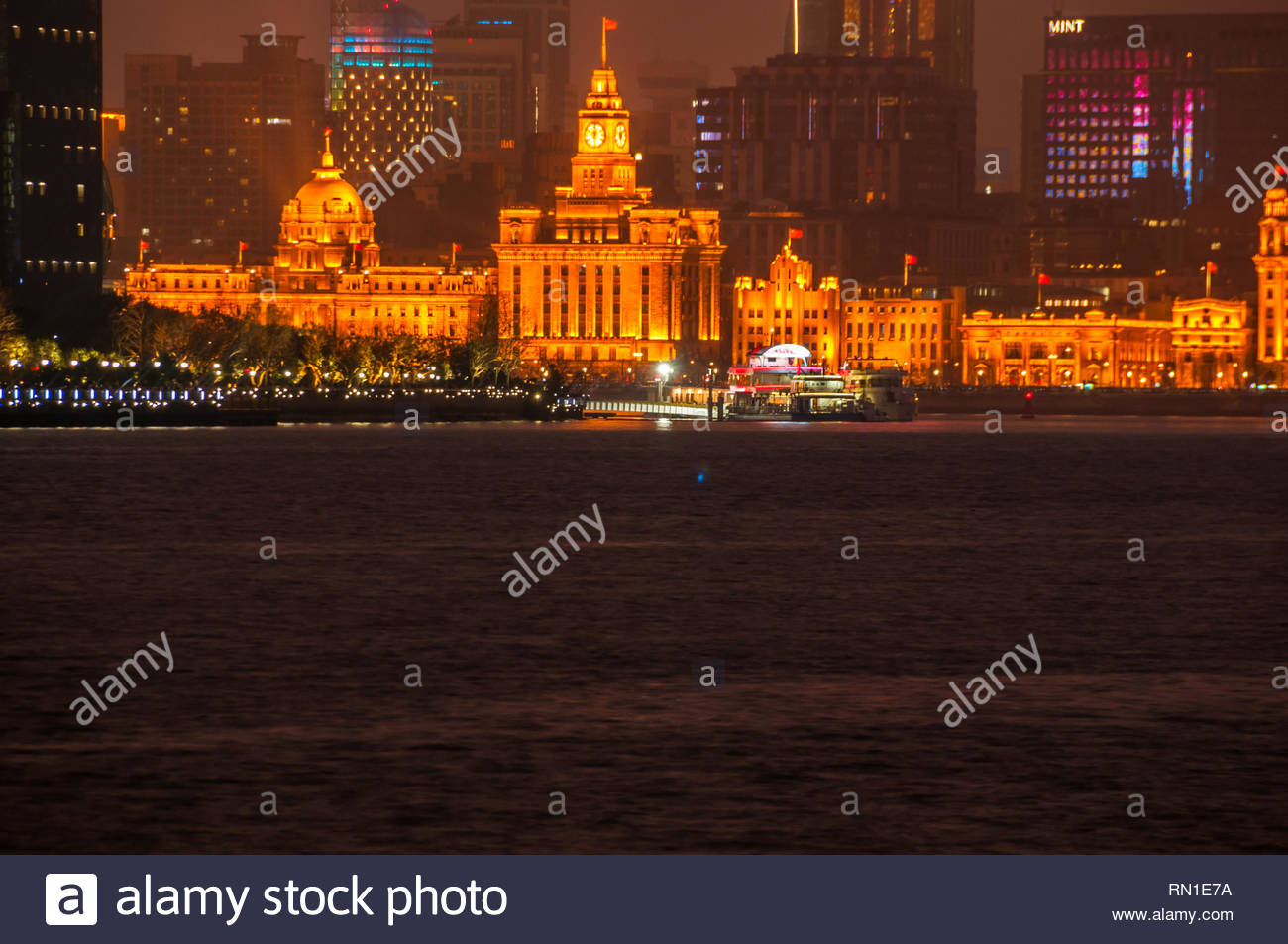 The historical architecture of the Bund including the Custom House and former Hong Kong and Shanghai Bank seen at night from the North Bund area. - Stock Image