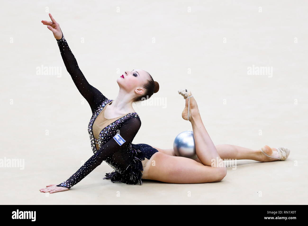 Moscow, Russia. 16th Feb, 2019. MOSCOW, RUSSIA - FEBRUARY 16, 2019: Rhythmic gymnast Nicol Voronkov of Israel performs her individual ball routine at the 2019 Alina Kabaeva Gazprom Champions Cup as part of the Gazprom for Children Programme at Moscow's Luzhniki Sports Complex. Sergei Savostyanov/TASS Credit: ITAR-TASS News Agency/Alamy Live News - Stock Image