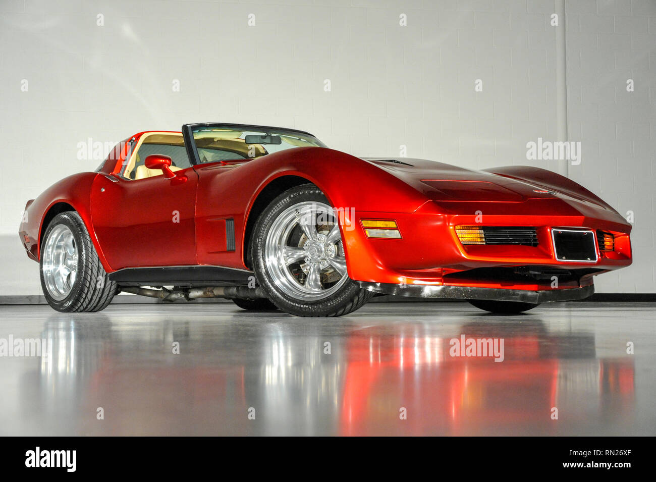Feb 11, 2019: 1980 Chevrolet Corvette in Candy Apple Red. Original L48, 350 ci. Stroked to 383 ci. Edelbrock RPM 64 cc heads, ported and polishedComp Cams, Xtreme Energy XE274 Roller CamRoller Rocker, SRP forged Flat Top Pistons w/ Molly ringsFully floated forged H-beam rods, Eagle forged crankAll ARP bolts, Hooker Comp Headers with electric cutoutsMSD 6AL Ignition, ( Replaced Sep. 2018) High capacity dual core radiatorMarch Serpentine belt system, Chrome AC, Painless Performance alternatorCustom valve covers and wire loomsMilodon 7 qt. oil pan with windage trayCustom exhaust with polished - Stock Image