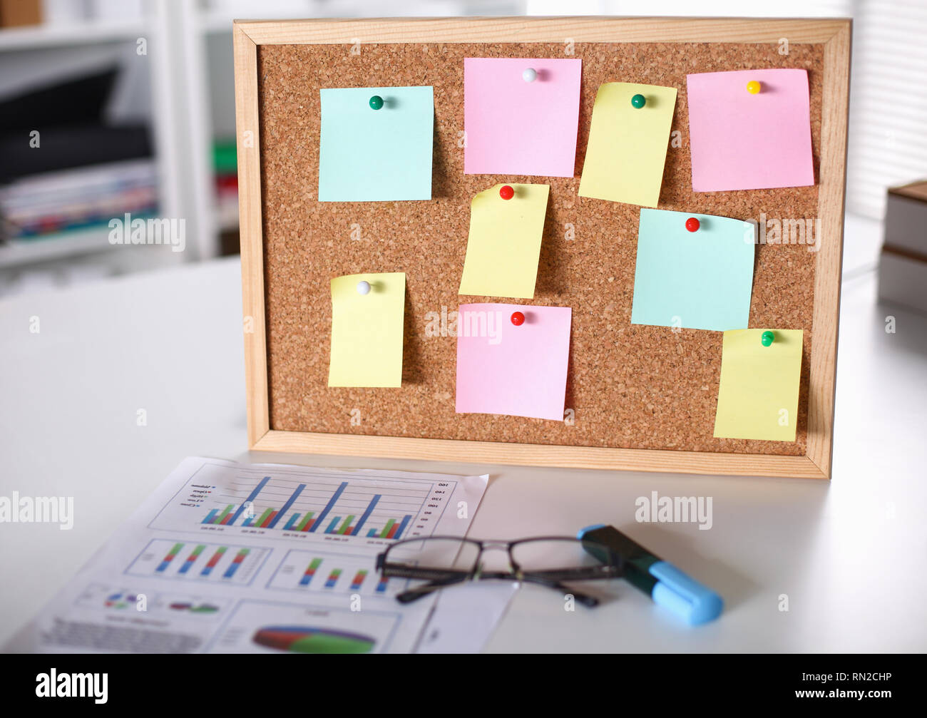 multicolored stickers on the board in the office - Stock Image