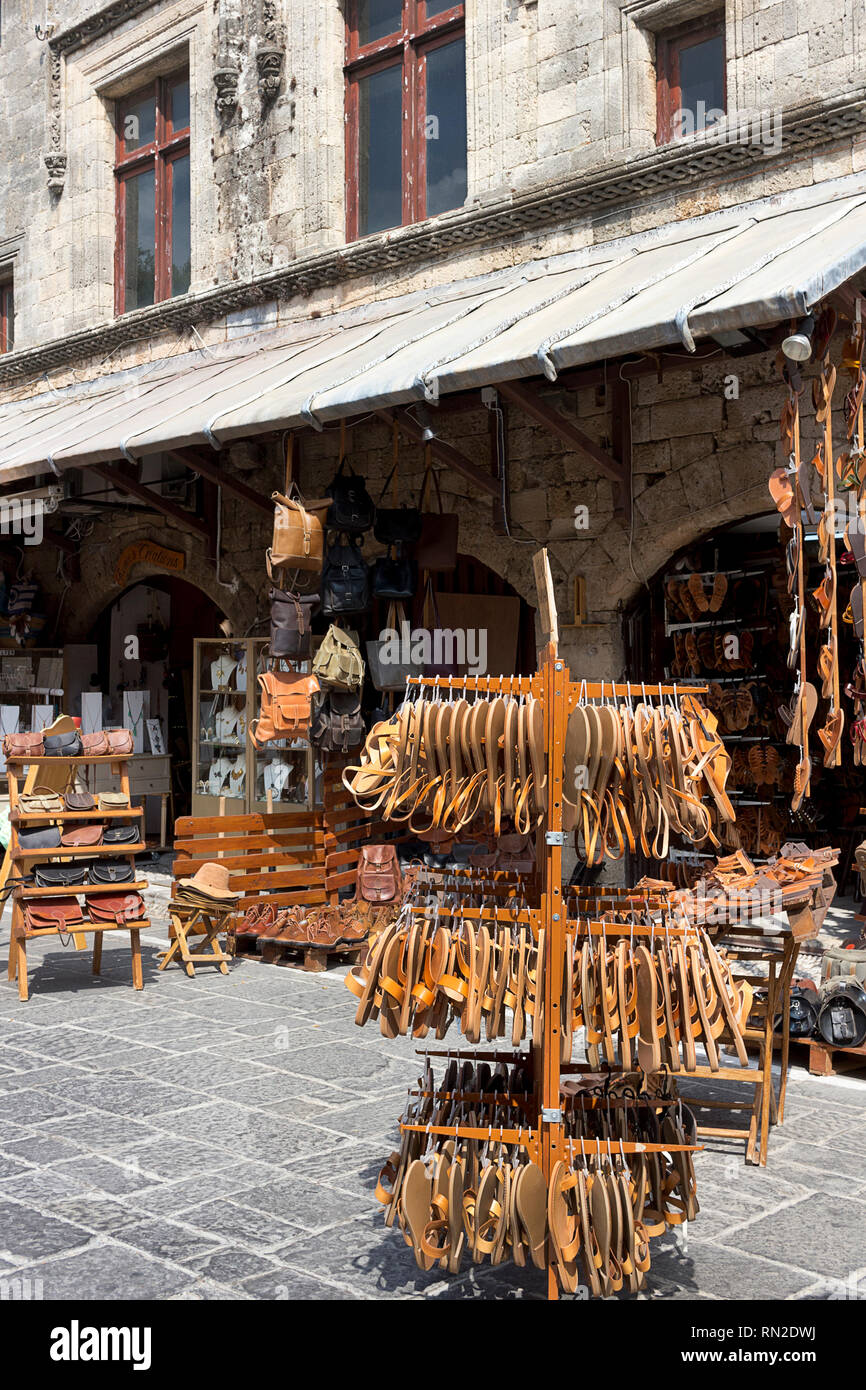 Rhodes island, Greece - September 12, 2018.  Handmade greek leather sandals and bags on display outside of a shop in a street of Rhodes Old City,  Dod - Stock Image