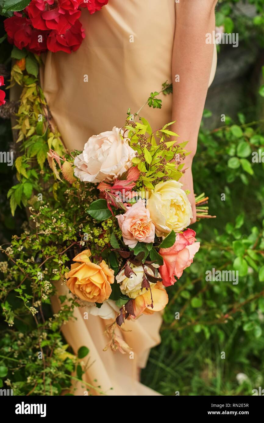 Wedding Photography A Bride In A Silk Wedding Dress Holding A