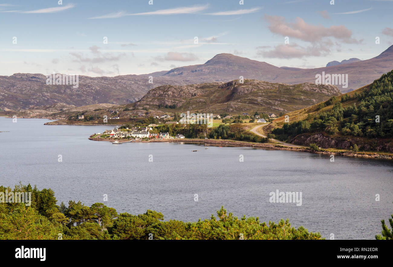 Shieldaig, Scotland, UK - September 24, 2013: Houses cluster on the seafront of the village of Shieldaig on the shores of Loch Torridon, with the moun - Stock Image