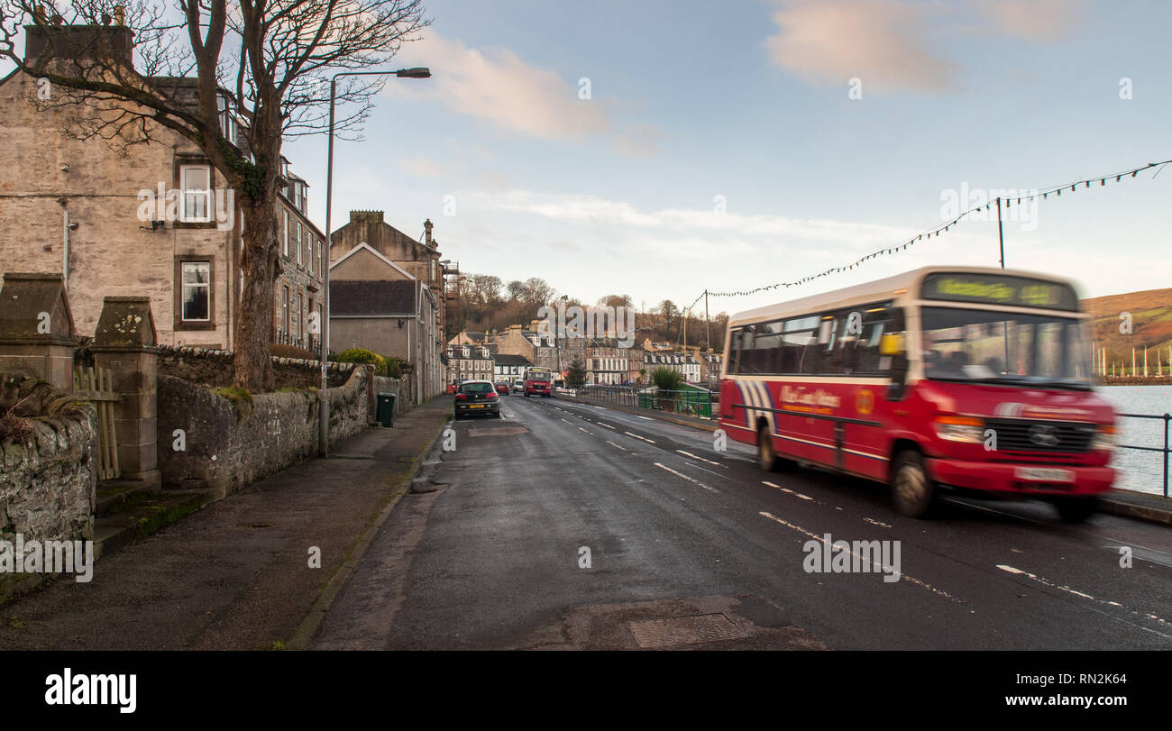 Port Bannatyne, Scotland, UK - 12 January 2012: A rural bus runs along the seafront of Kames Bay at Port Bannatyne on the Isle of Bute in Scotland. - Stock Image