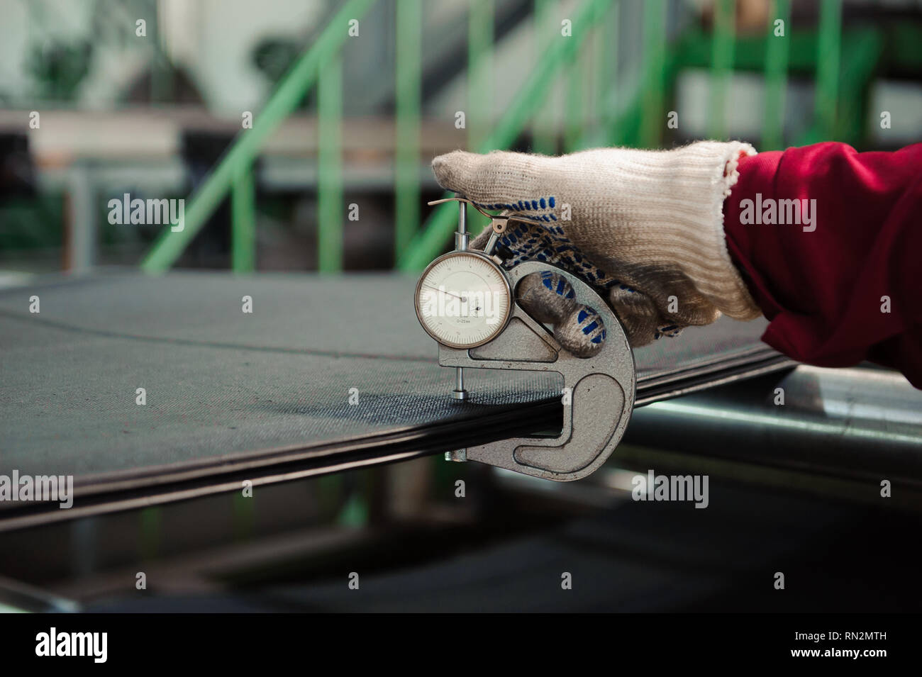 Worker tests production at the rubber plant. - Stock Image