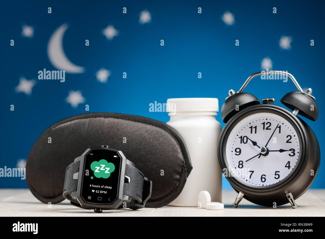 Watch, mask, pills and clock - Stock Image