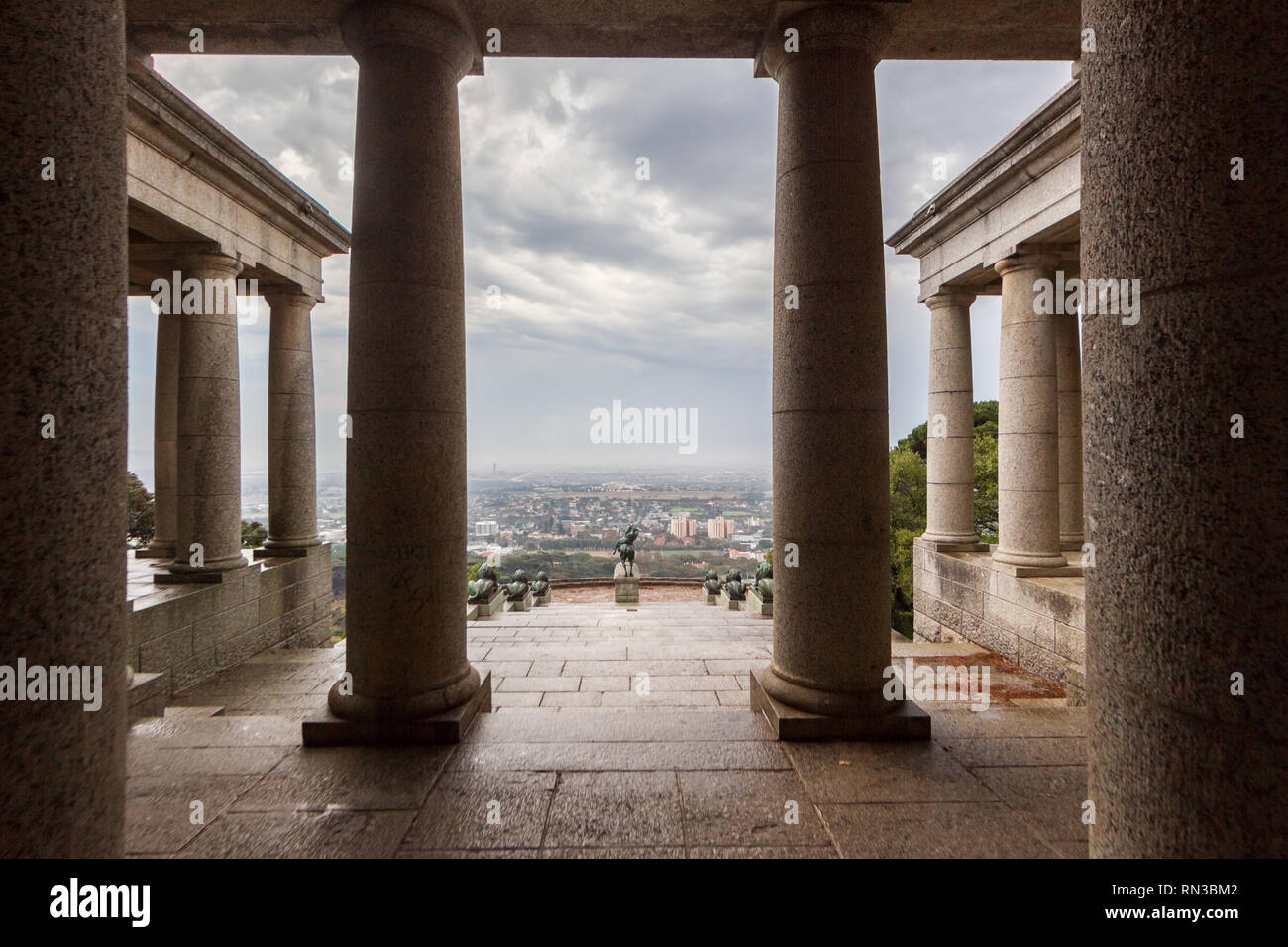 Rhodes Memorial is a masssive stone monument on the slopes of Devil's Peak overlooking the Cape Town suburbs of Mowbray and Rondebosch, South Africa. - Stock Image