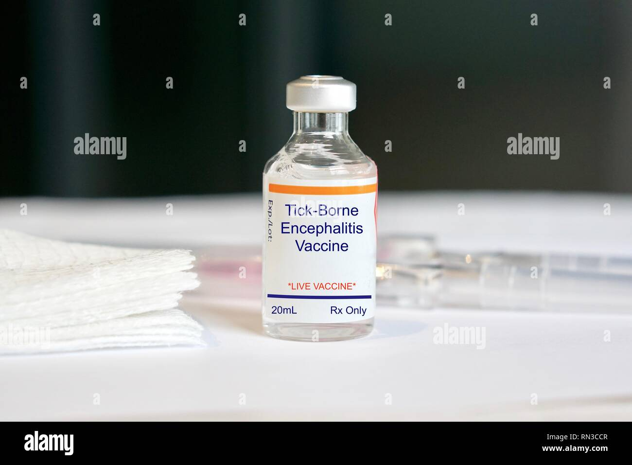 Tick one encephalitis Vaccine in a glass vial in a medical setting - Stock Image