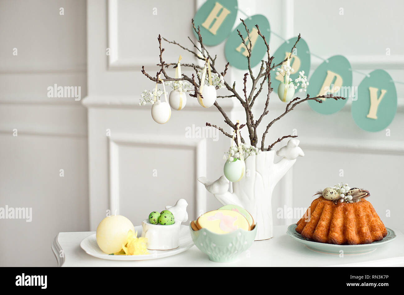 Festive Decoration Of The Easter Table A Vase With A Branch And