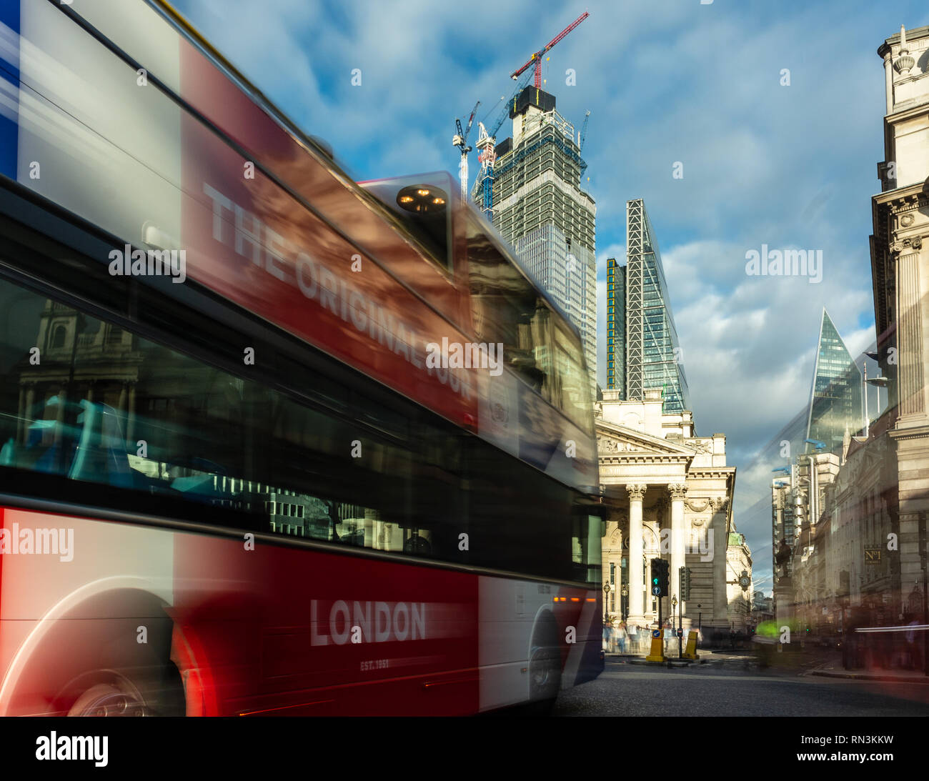 London, England, UK - September 14, 2018: An open top double-decker tour bus passes through the busy Bank junction with the Royal Exchange building an - Stock Image